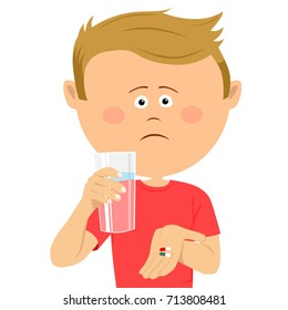 Unhappy little boy with glass of water shows two pils