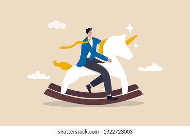Unicorn start up, winner creative idea to earn money and make profit in real life concept, smart success businessman company founder or billionaire investor riding unicorn rocking horse into the sky.