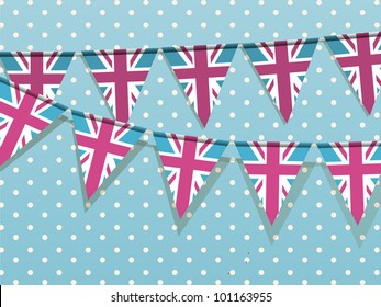Union jack bunting on a blue polka dot background