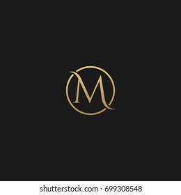 Unique modern creative elegant circular shaped fashion brands black and gold color M initial based letter icon logo.
