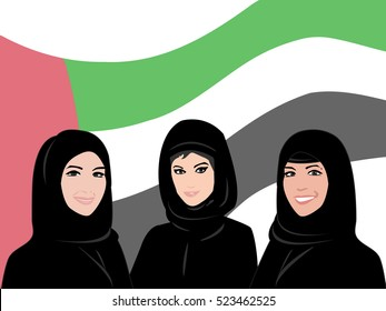 United Arab Emirates National Day - Arab women with United Arab Emirates flag in the background
