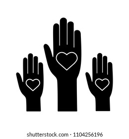 Unity in diversity glyph icon. Silhouette symbol. No to racism. Volunteers. Helping hands. Voting. Charity. Negative space. Vector isolated illustration