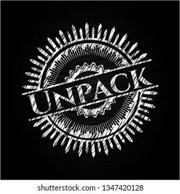 Unpack chalkboard emblem written on a blackboard