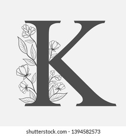 Uppercase Letter K with flowers and branches. Vector flowered monogram or logo. Hand Drawn concept. Botanical design branding. Composition of letter and flowers for wedding card, invitations, brand.