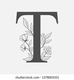 Uppercase Letter T with flowers and branches. Vector flowered monogram or logo. Hand Drawn concept. Botanical design branding. Composition of letter and flowers for wedding card, invitations, brand.