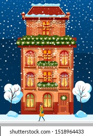 Urban brick building, housing for people. Facade, front exterior on Christmas holiday, snowy trees near and Xmas decor. Festive decoration like garlands from fir branches and light lamps