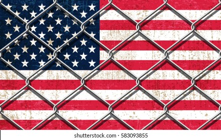 USA Flag behind steel wire fence.