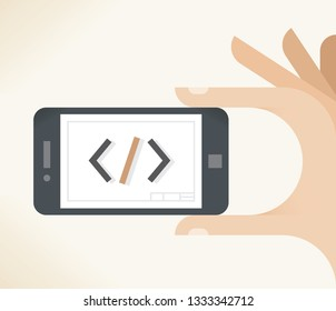 User holding cell phone with coding symbols on screen  online services etc.