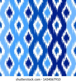 Uzbek ikat silk fabric pattern, indigo blue and white colors. Seamless geometric pattern, based on ikkat fabric style. Vector illustration. Carpet rug texture vector imitation.