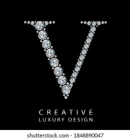 V diamond letter vector illustration. White gem symbol logo for your luxury business, casino, jewelry or web site. Upper letter with many sparkling diamonds isolated on black background.