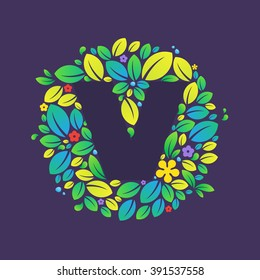 V letter logo in a circle of leaves and flowers. Font style, vector design template elements for your vegan or ecology application or corporate identity.