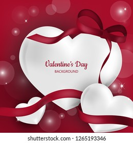Valentine's Day background with red heart and ribbon.