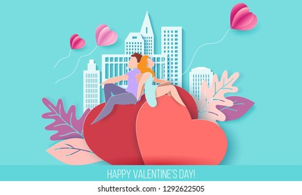 Valentines day card with couple holding hands in love and sitting on red hearts background with modern sity and air balloons. Vector paper art illustration. Paper cut and craft style.