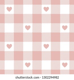 Valentine's Day gingham / vichy check plaid pattern in pink for romantic cloth designs. Seamless tile with light pink hearts. Striped texture.