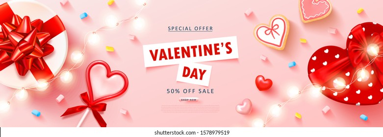 Valentine's day sale background with heart lollipop,cookies, streamers,gift box,marshmallow and garland. Modern design.Universal vector background for poster, banners, flyers, card,advertising brochur