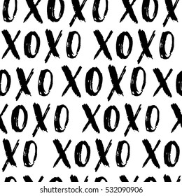 Valentine's Day vector seamless pattern. Hand written doodle XO XO on white isolated background. Cute pattern label design.