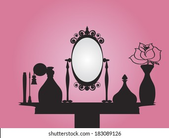 Vanity table with mirror and beauty products over pink background