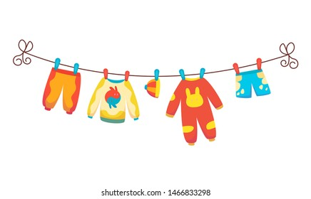 Various items of baby clothes on rope isolated vector illustration on white background. Laundry held by plastic pegs drying.
