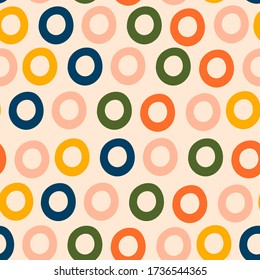 Various round Rings. Donut shapes. Different colors. Colorful abstract Seamless pattern. Background, wallpaper. Hand drawn Vector illustration. Pastel colors