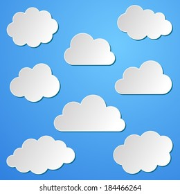 Various white paper clouds collection on blue background