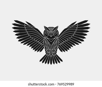 Vector. Abstract polygonal owl with open wings. Black geometric pattern bird.