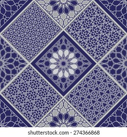Vector abstract seamless patchy pattern from light grey and white geometric Oriental ornaments, stylized flowers, stars and radial rosette on dark indigo blue background