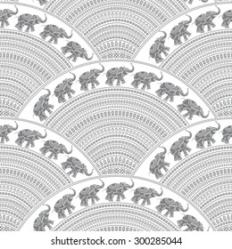 Vector abstract seamless pattern from small elephant grey silhouette with decorative ethnic ornaments on a white background. Regular fan shaped ornamental elements