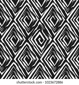 Vector abstract seamless pattern whit drawn by brush rhombuses.Modern stylish texture.Black and white