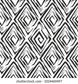 Vector abstract seamless pattern whit drawn by brush rhombuses.Modern stylish texture.White and black