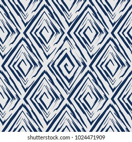 Vector abstract seamless pattern whit drawn by brush rhombuses.Modern stylish texture.Blue background
