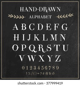 Vector alphabet and numbers set. Handwriting white letters and signs in vintage chalk style on black background.  Font was inspired from vintage Early 1900's tattoo's