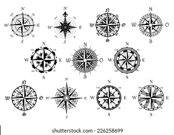 Vector antique compasses with ornate dials for use as design elements in vintage or retro nautical and marine concepts, black and white