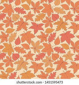 Vector autumn seamless pattern with oak, poplar, beech, maple, aspen and horse chestnut leaves of orange and red colors on the yellow dotted background. Fall ornament with detailed foliage.