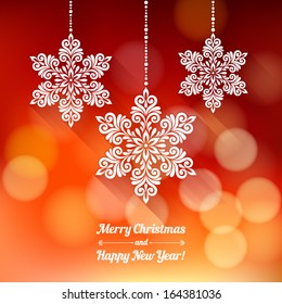Vector background with Christmas decoration for your design. Vintage ornamental snowflakes on defocus background. Happy New Year greeting card