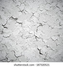 Vector background - gray wall covered with cracks and stains