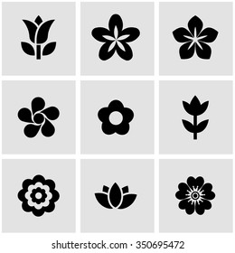 Vector black flowers icon set.