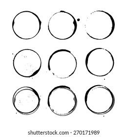 Vector black shapes of Wine circle and Coffee ring stains. Wine glass marks or coffee cup round stains and dirty splashes and spots isolated. Hand drawn tea or ink ring stains on white background.