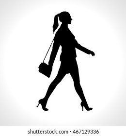 Vector black silhouette of walking businesswoman, isolated