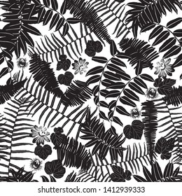 Vector black and white sillouette seamless pattern with ferns, leaves and wild flower. Suitable for textile, gift wrap and wallpaper.