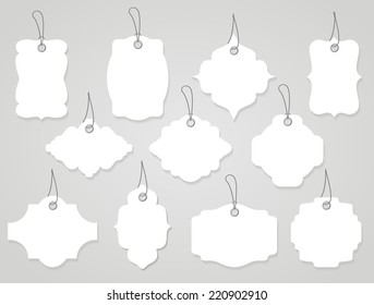 Vector blank labels or tags white with ropes