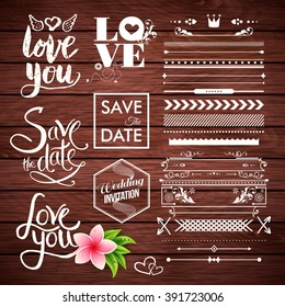 Vector borders, lines, arrows and save the date with wedding invitation labels on wooden background