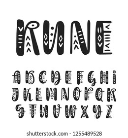 Vector brush pen handwritten uppercase alphabet decorated with ethnic ornaments.
