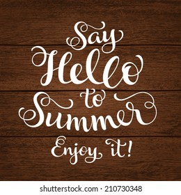 "Vector calligraphic inscription with ornamental elements on wood background. ""Say Hello to Summer. Enjoy it!"" poster or postcard. Typography collection, vacation illustration"