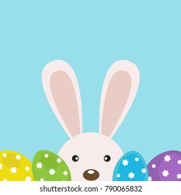 Vector card for Easter. Cute rabbit with Easter eggs.