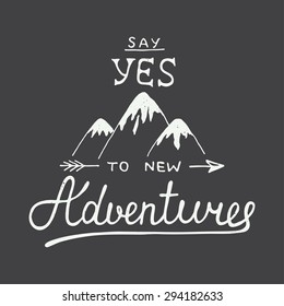 Vector card with hand drawn unique typography design element and mountains for greeting cards and posters. Say yes to new adventures in vintage style