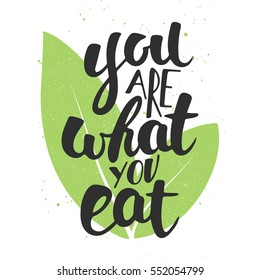 Vector card with hand drawn unique typography design element for greeting cards, decoration, prints and posters. You are what you eat, modern ink brush calligraphy with leaves. Handwritten lettering.