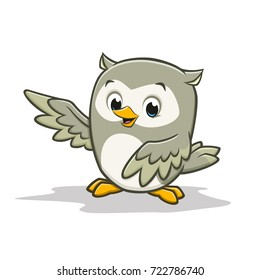 Vector cartoon illustration of a cute happy baby owl