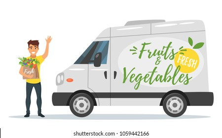 Vector cartoon style farmers fruit and vegetables delivery car with the smiling deliverer waves his hand and holding fresh veggies. Isolated on white background.