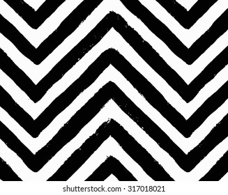 Vector chevron seamless pattern. Textured grunge geometric background for wallpaper, gift paper, fabric print, furniture. Zigzag print. Unusual painted ornament from brush strokes. Black and white.