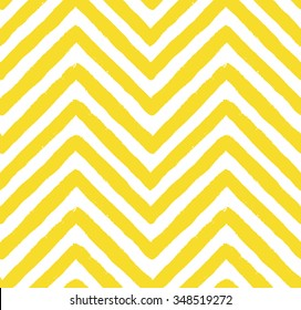 Vector chevron seamless pattern. Textured grunge geometric background for wallpaper, gift paper, fabric print, furniture. Zigzag print. Unusual painted ornament from brush strokes. Yellow and white